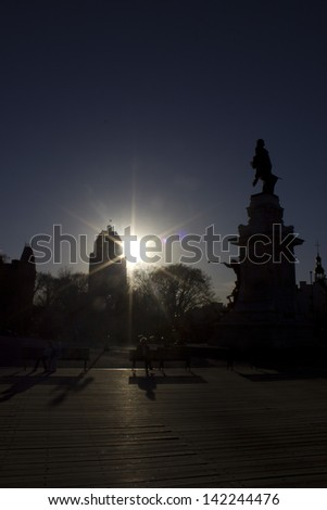 Backlit backlight on Frontenac statue and Price Edifice - stock photo