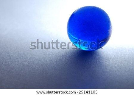 Backlit blue marble on white paper