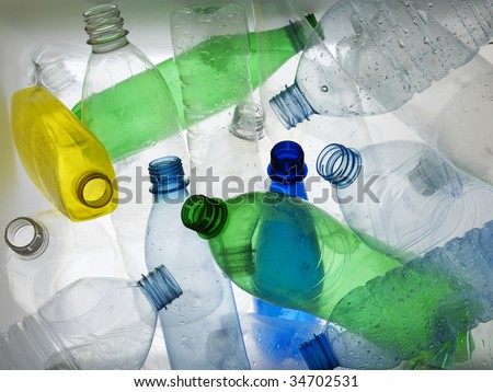Backlit collection of colourful plastic bottles - stock photo