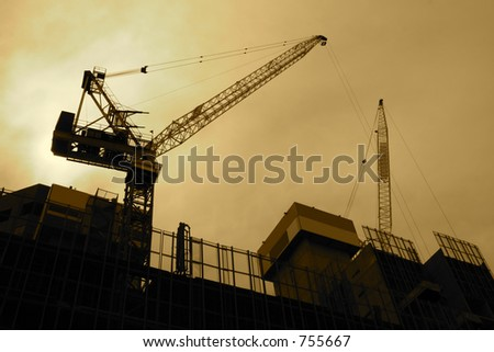 Backlit construction zone in sepia tones. - stock photo