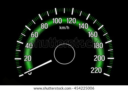 Backlit gauges of an automobile. Green glowing meters speedometer isolated on black background