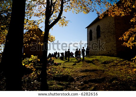 Backlit image of a  group of hikers leaving the Oka Calvary - stock photo