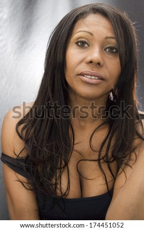 Backlit Portrait of  Beautiful Black Woman  over black background