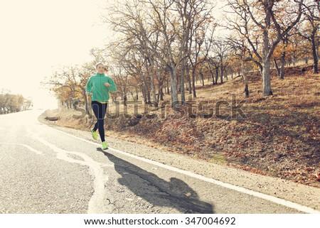 Backlit runner  - stock photo