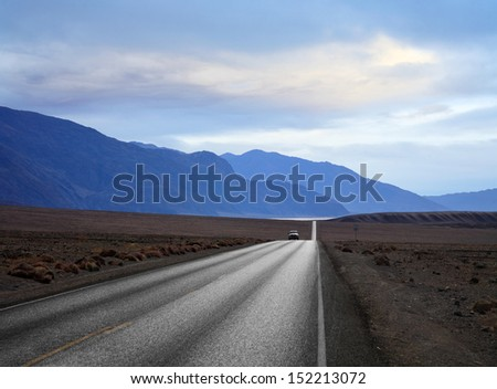 Backlit Scene, Pickup Truck On A Desert Highway, Death Valley National Park, California, USA