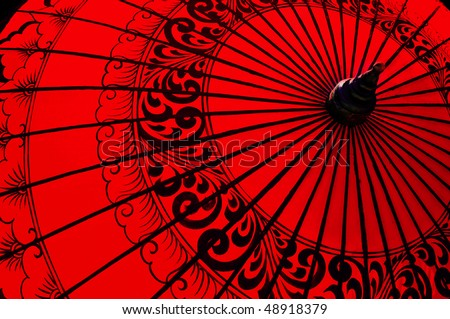 Backlit traditional Burmese umbrella - stock photo