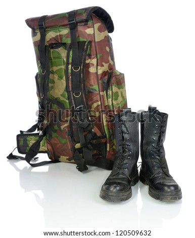 Backpack and hiking boots. - stock photo
