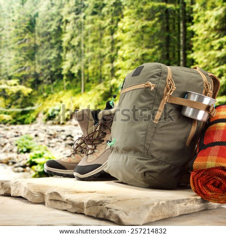 backpack on stone and shoes  - stock photo