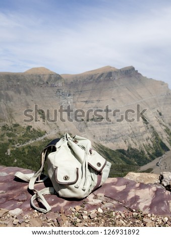 backpack on top of the mountain - stock photo