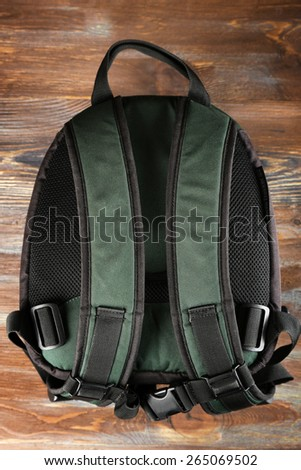 Backpack on wooden background - stock photo