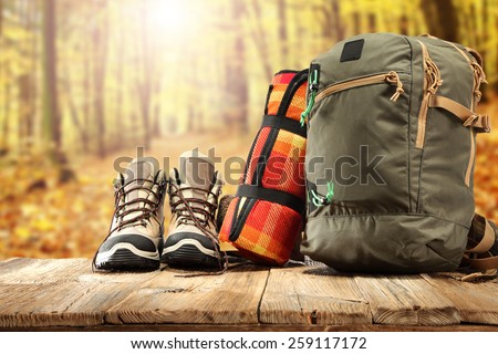 backpack shoes and forest of sun light  - stock photo