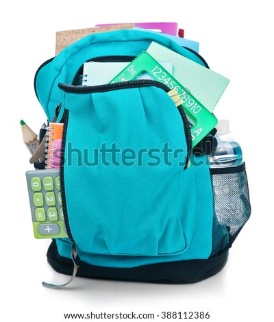 Backpack with school supplies, isolated on white - stock photo