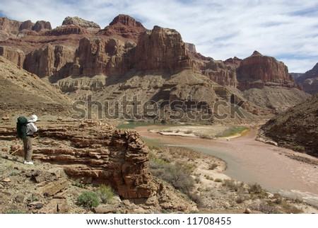 Backpacker at the confluence of the Little Colorado River, Grand Canyon, Arizona - stock photo