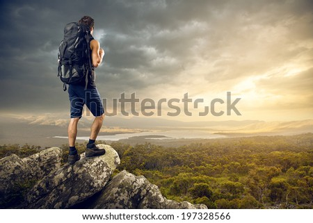 Backpacker enjoys a nice view - stock photo