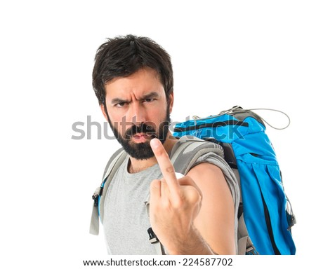 Backpacker making horn gesture over white background