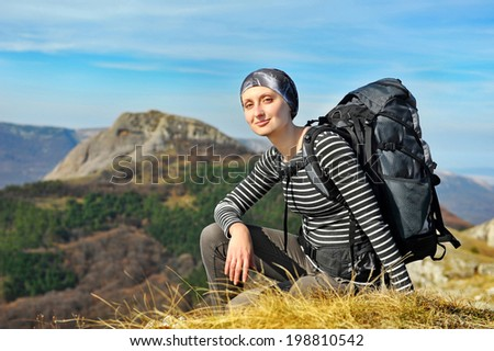 backpacker on mountains background - stock photo