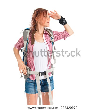 backpacker showing something over isolated white background