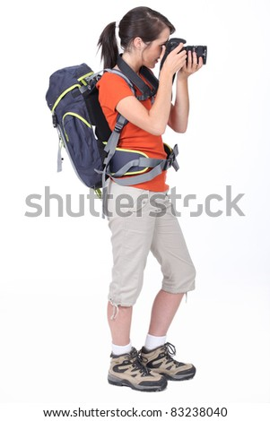 Backpacker with a camera - stock photo