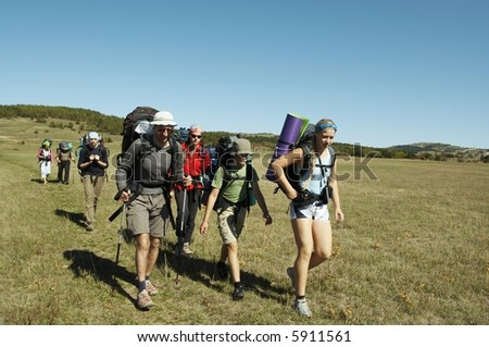 Backpackers going up in Crimean mountain - stock photo