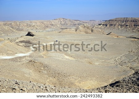 Backpackers on the footpath in crater Ramon, Israel                                - stock photo
