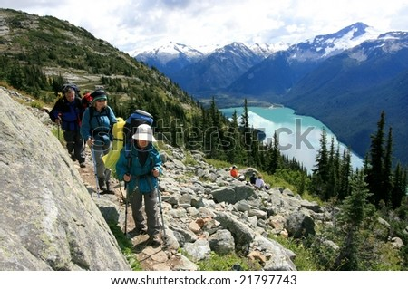 Backpackers on the High Note Trail above Cheakamus Lake near Whistler, British Columbia, Canada. - stock photo