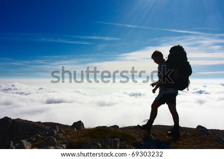 Backpackers silhouette - stock photo