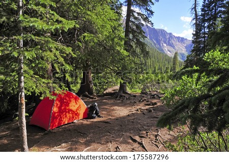 Backpacking: Camping with Tent in the Mountains - stock photo