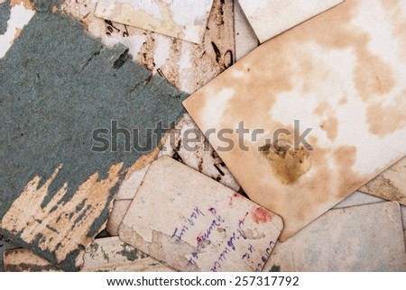 Backs of old photographs. Aged paper background. - stock photo
