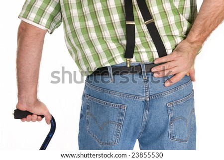 Backside of an adult walking with a cane. - stock photo
