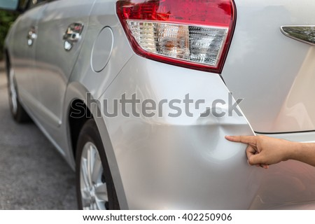 Backside of new silver car get damaged by accident - stock photo