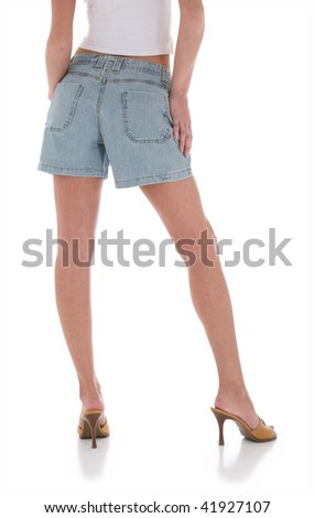 Backside of Young Woman in Jean Shorts with Nice Legs - stock photo