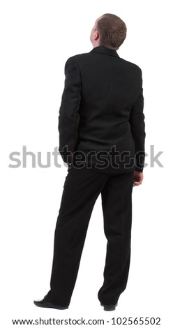 backside view of person. back view of Businessman watching. Young guy in black suit looks ahead.  Rear view people collection.    Isolated over white background - stock photo