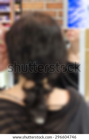 Backstage scene professional Make-up artist doing glamour model makeup at work blur background - stock photo