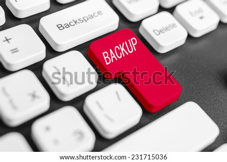 Backup button on computer keyboard, colored in red. - stock photo