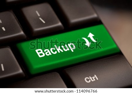 Backup Computer Key In Green For Archiving And Storage - stock photo