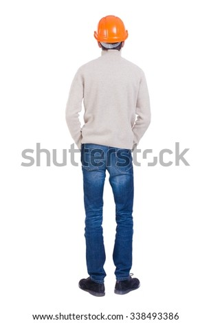 Backview of an engineer in construction helmet stands. Standing young guy. Rear view people collection.  backside view of person.  Isolated over white background.  - stock photo