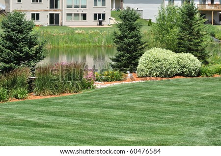 Backyard Landscaping with Lawn and Pond - stock photo