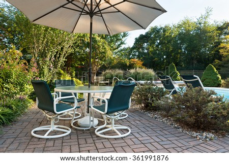 Backyard Patio and Landscaped Yard - stock photo