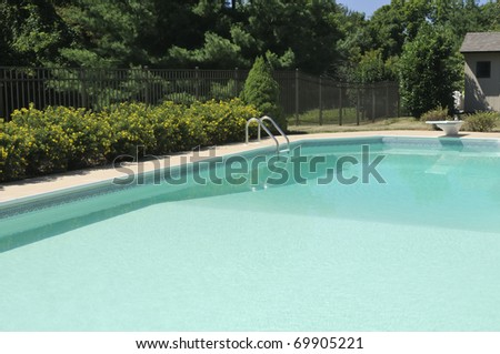 Backyard pool with diving board - stock photo