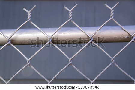 Backyard Re-Painted Metal Chain Link Fence Top Post Wire - stock photo