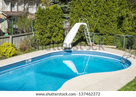 Backyard Swimming Pool - stock photo