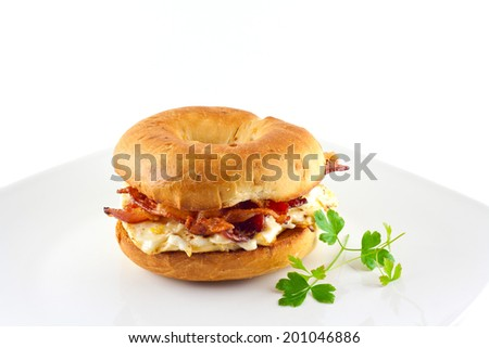 Bacon and egg sandwich on an onion bagel.