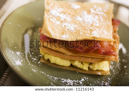 Bacon and Egg stacked on a pastry shell
