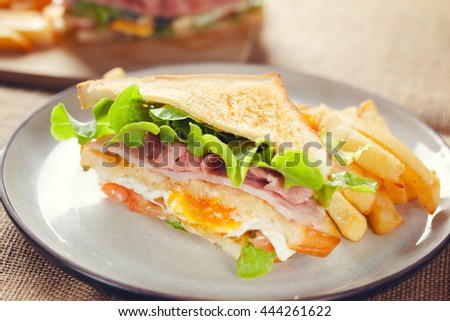 bacon and ham sandwich with french fries
