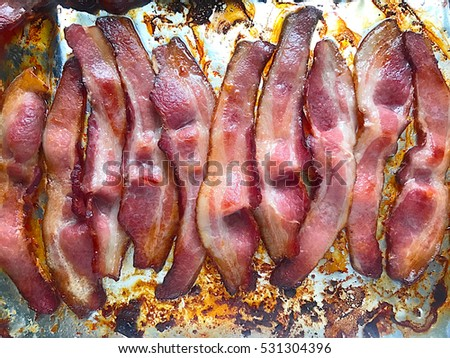 Bacon cooked on foil in the oven