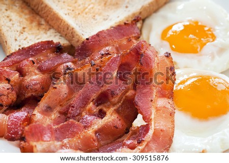 bacon,fried egg ,bread for breakfast close up - stock photo