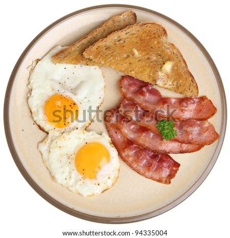 Bacon, fried eggs and buttered toast - stock photo