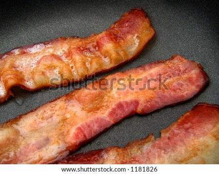 bacon frying in a nonstick skillet