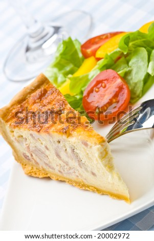 Bacon quiche with salad on a plate - stock photo