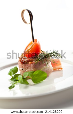 Bacon Wrapped Beef with Cherry Tomato - stock photo